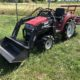 Compact tractor with front loader and rotavator