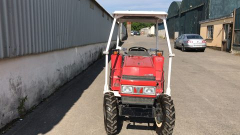 Compact tractor with roof and rotavator