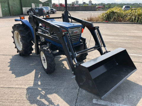 Large compact tractor with loader